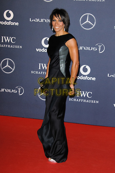 Dame Kelly Holmes.Arrivals at the Laureus 2012 World Sports Awards held at the Queen Elizabeth II Centre, London, England..February 6th, 2012.full length black dress side .CAP/CJ.©Chris Joseph/Capital Pictures.