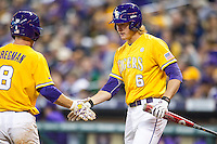 LSU Tigers outfielder Andrew Stevenson (6) is greeted by teammate Alex Bregman (8) after scoring during the Houston College Classic against the Nebraska Cornhuskers on March 8, 2015 at Minute Maid Park in Houston, Texas. LSU defeated Nebraska 4-2. (Andrew Woolley/Four Seam Images)