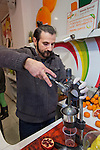 Istanbul - Turkey - 04 February 2015 -- Young entrepreneurs. -- Bilal Kandemir, 32, a fruit juice seller, presses a grenade juice  -- PHOTO: Agata SKOWRONEK / EUP-IMAGES