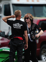 Mar. 9, 2012; Gainesville, FL, USA; NHRA pro stock motorcycle rider Charlie Sullivan (left) with daughter Katie Sullivan during qualifying for the Gatornationals at Auto Plus Raceway at Gainesville. Mandatory Credit: Mark J. Rebilas-