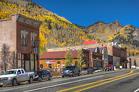 The small town of Rico Coloardo with Aspen trees turning bright yellow in the surrounding mountains.