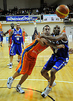 Brendon Polyblank competes for the ball with Saints import Erron Maxey (right). NBL - Wellington Saints v Southland Sharks at TSB Bank Arena, Wellington, New Zealand on Friday, 22 April 2011. Photo: Dave Lintott / lintottphoto.co.nz