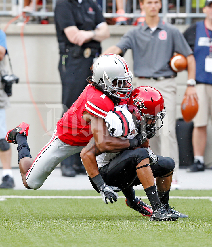Ohio State Buckeyes cornerback Bradley Roby (1) makes a tackle on San Diego State Aztecs wide receiver Colin Lockett (24) during the 2nd quarter of their college football game at Ohio Stadium in Columbus on September 7, 2013.  (Dispatch photo by Kyle Robertson)