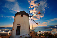 Sunset over the The traditional Greek windmills of Mykonos Upper Chora. Cyclades Islands, Greece