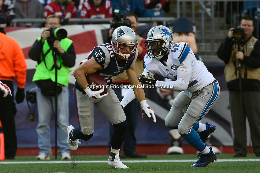 November 23, 2014 - Foxborough, Massachusetts, U.S.- New England Patriots wide receiver Danny Amendola (80) breaks a tackle from Detroit Lions strong safety Isa Abdul-Quddus (42) during the NFL game between the Detroit Lions and the New England Patriots held at Gillette Stadium in Foxborough Massachusetts. The Patriots defeated the Lions 34-9. Eric Canha/CSM