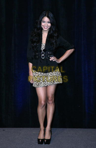 VANESSA HUDGENS .CBS Films ShoWest Luncheon at the Paris Resort Hotel and Casino,  Las Vegas, Nevada, USA,.18th March 2010..full length black hand on hip leopard print dress platform peep toe shoes jacket animal .CAP/ADM/MJT.© MJT/AdMedia/Capital Pictures.