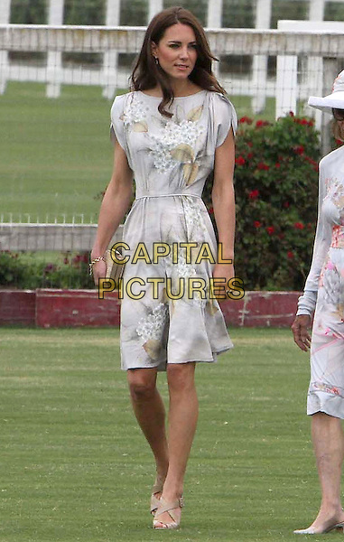 Catherine, Duchess of Cambridge.Audi At The Foundation Polo Challenge held at the Santa Barbara Polo & Racquet Club, Santa Barbara, California, USA, 9th July 2011..full length grey gray white flower floral print dress beige clutch bag shoes  sandals kate middleton princess royal royalty .CAP/ADM/KB.©Kevan Brooks/AdMedia/Capital Pictures.