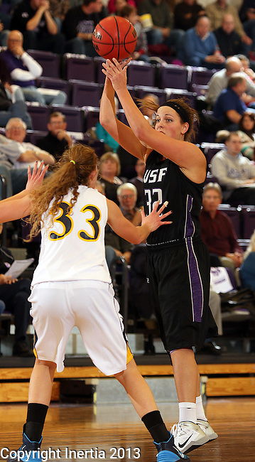 SIOUX FALLS, SD - DECEMBER 7:  Laura Johnson #32 from the University of Sioux Falls passes the ball over the top of Hayley McCarron #33 from Augustana in the second half of their game Saturday evening at the Stewart Center. (Photo by Dave Eggen/Inertia)