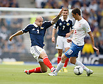 Alan Hutton tackles Srdan Mijailovic