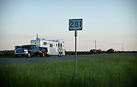 A trailer heads passes a sign Highway 281 in Hill Country, Texas, on April 25, 2010. The historic highway offers many attractions including Fossil Rim Nature Park, many spring time flowers, and a wonderful view of hill country in central Texas...PHOTOS/ MATT NAGER