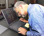 Andreas Constantino, preparing the slide show for the Celebration of 35th Anniversary of Newsday Investigations Team held in Newsday Auditorium in Melville on Thursday September 26, 2002. (Newsday photo by Jim Peppler).