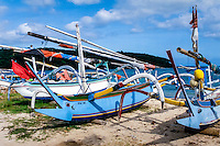 Bali, Karangasem, Padangbai. The local perahu-boats can be very colourful. The big eyes in the front is supposed to help the boat navigate through the darkness.