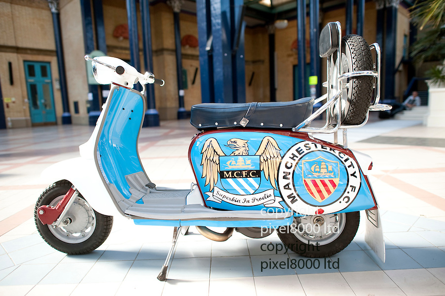 LONDON INTERNATIONAL CLASSIC AND CUSTOM SHOW  - Alexandra Palace  - 26.2.12.Scooter customised in Manchester City colours...Picture by Gavin Rodgers/ Pixel8000. 07917221968