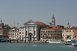 Looking at the waterfront showing hotels, churches and waterbuses. Venice, Italy.