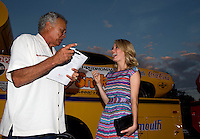 Aug. 29, 2013; Avon, IN, USA: NHRA former driver Don Prudhomme (left) and actress Ashley Hinshaw during the premiere of Snake & Mongoo$e at the Regal Shiloh Crossing Stadium 18. Mandatory Credit: Mark J. Rebilas-