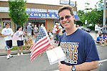 Charles Rosenblum, a Merrick Kiwanis member, marching in Merrick Memorial Day Parade on May 28, 2012, on Long Island, New York, USA. Rosenblum's father, American Legion member Everett Rosenblum, was Parade Grand Marshall. America's war heroes are honored on this National Holiday.