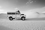 Africa, Tunisia, nr. Ksar Rhilane. Desert traveller Siegfried and Gernot driving their 1978 Land Rover Series 3 Dormobile through a sandfield close to Ksar Ghilane on the eastern edge of the Grand Erg Oriental. --- No releases available, but releases may not be needed for certain uses. Automotive trademarks are the property of the trademark holder, authorization may be needed for some uses.  --- Info: Image belongs to a series of photographs taken on a journey to southern Tunisia in North Africa in October 2010. The trip was undertaken by 10 people driving 5 historic Series Land Rover vehicles from the 1960's and 1970's. Most of the journey's time was spent in the Sahara desert, especially in the area around Douz, Tembaine, Ksar Ghilane on the eastern edge of the Grand Erg Oriental.