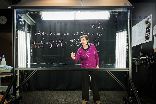 February 15, 2017; Associate Teaching Professor Anne Pilkington works at the light board in Jordan Hall of Science. (Photo by Matt Cashore/University of Notre Dame)
