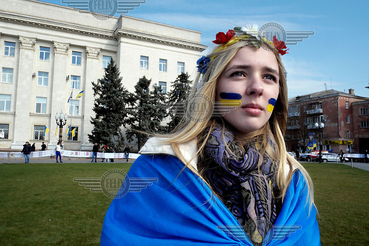 A young activist, with the Ukrainian flag painted on her face, attends a pro-Europe, pro-united Ukraine rally on the 40th day after the deaths of many protestors in clashes with security forces in Kiev. Events that led to the collapse of the ruling Party of the Regions and the ousting of President Viktor Yanukovych. Protests against the government of President Viktor Yanukovych were sparked on 21 November 2013 by the Ukrainian government's decision to suspend preparations for the signing of an association agreement with the European Union that would have increased trade with the EU. Some believe that the U-turn came about as a result of pressure from President Putin of Russia who wants Ukraine to join a customs union with itself, Kazakhstan and Belarus. Russia offered 15 billion dollars of soft loans and reduced price gas to Ukraine at the same time as discussions with the EU were taking place. After weeks of protests and a number of deaths, Prime Minister Mykola Azarov and the entire cabinet resigned. On 18 February, after Yanukovych's party scuppered a move to change the constitution to reduce the powers of the president, renewed fighting between protesters and police broke out and had cost the lives of around 80 people by Friday 21st February. By 22 February Yanukovych had fled Kiev. In the days following the Ukrainian parliament decided to strip him of the presidency.