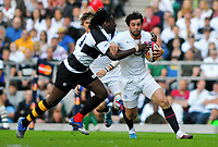 Ben Foden in possession of the ball is tackled by Paul Sackey. MasterCard Trophy International match between England and the Barbarians on May 30, 2010 at Twickenham Stadium in London, England. [Mandatory Credit: Patrick Khachfe/Onside Images]