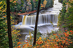 A very picturesque waterfall in motion blur, Tahquamenon Falls in autumn, Michigan's Upper Peninsula, USA
