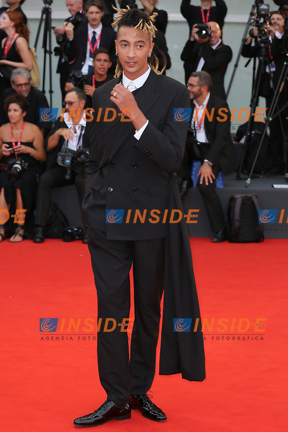 "VENICE, ITALY - AUGUST 28: Ghali walks the red carpet ahead of the Opening Ceremony and the ""La Verite"" (The Truth) screening during the 76th Venice Film Festival at Sala Grande on August 28, 2019 in Venice, Italy., 2019 in Venice, Italy. (Photo by Marck Cape/Inside Foto)<br /> Venezia 28/08/2019"