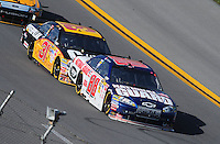 Apr 26, 2009; Talladega, AL, USA; NASCAR Sprint Cup Series driver Dale Earnhardt Jr (88) leads Jeff Burton (31) during the Aarons 499 at Talladega Superspeedway. Mandatory Credit: Mark J. Rebilas-