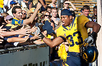 Covaughn DeBoskie-Johnson celebrates with fans. The California Golden Bears defeated the UCLA Bruins 35-7 at Memorial Stadium in Berkeley, California on October 9th, 2010.