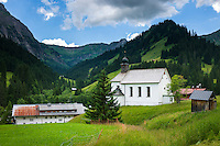 Austria, Vorarlberg, Kleinwalsertal, village Baad at valley end with church Saint Martin | Oesterreich, Vorarlberg, Kleinwalsertal, Baad: am Ende des Kleinwalsertals mit Expositurkirche Sankt Martin, die unter Denkmalschutz steht