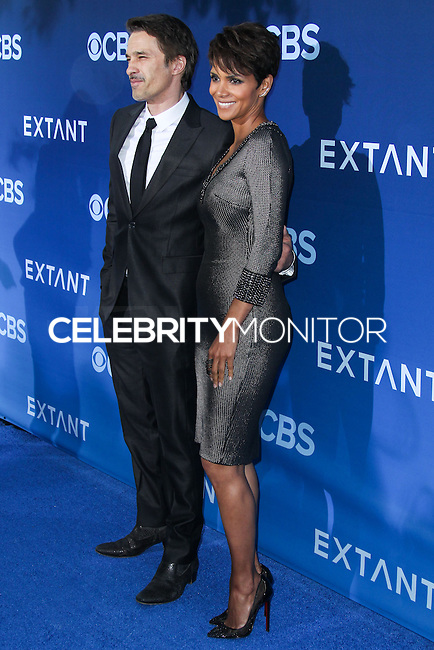 LOS ANGELES, CA, USA - JUNE 16: Olivier Martinez and Halle Berry arrive at the Los Angeles Premiere Of CBS Films' 'Extant' held at the California Science Center on June 16, 2014 in Los Angeles, California, United States. (Photo by Xavier Collin/Celebrity Monitor)