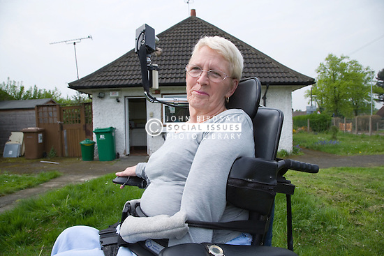 Portrait of a woman with cerebral Palsy outside in the garden of a bungalow,