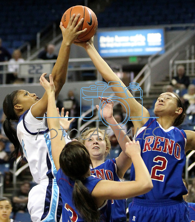 Centennial's Jada Brown shoots over Reno defenders Giuliana Hascheff, Morgan McGwire and Shalen Shaw during a semi-final game at the NIAA 4A State Basketball Championships between Centennial and Reno high schools at Lawlor Events Center in Reno, Nev, on Thursday, Feb. 23, 2012. Reno won 60-41. .Photo by Cathleen Allison