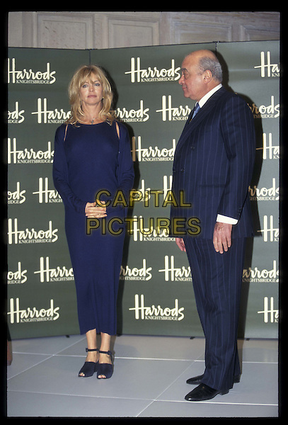 GOLDIE HAWN & MOHAMMED AL FAYED.At Harrods.08 January 1997.Ref: 4466.full length, full-length.*RAW SCAN- photo will be adjusted for publication*.www.capitalpictures.com.sales@capitalpictures.com.©Capital Pictures