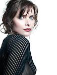 Beautiful brunette in black blouse, close up