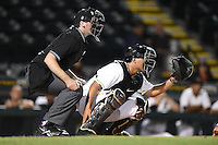 Home plate umpire Nate Tomlinson and Bradenton Marauders catcher Jin-De Jhang (47) during a game against the Palm Beach Cardinals on April 8, 2014 at McKechnie Field in Bradenton, Florida.  Bradenton defeated Palm Beach 4-3.  (Mike Janes/Four Seam Images)