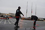 """Corrections officers use orange tape to seal off the media from the entrance to the Greensville Correctional Center hours before the 9 p.m. execution of John Allen Muhammad, the so-called """"Washington sniper"""" responsible for gunning down 10 and wounding three in the D.C.-area in 2002, in Jarrat, Virginia on November 10, 2009.  Virginia Governor Tim Kaine refused to grant a stay of clemency and the U.S. Supreme Court turned down the request for a stay of execution despite religious objections due to Muhammad's mental health."""