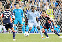 CJ Sapong (17) forward Sporting KC watched by AJ Soares New England... Sporting Kansas City defeated New England Revolution 3-0 at LIVESTRONG Sporting Park, Kansas City, Kansas.
