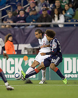 Toronto FC midfielder Dwayne De Rosario (14) attempts to pass as New England Revolution defender Kevin Alston (30) defends. The New England Revolution defeated Toronto FC, 4-1, at Gillette Stadium on April 10, 2010.