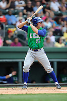 Third baseman Hunter Dozier (13) of the Lexington Legends bats in a game against the Greenville Drive on Friday, August 18, 2013, at Fluor Field at the West End in Greenville, South Carolina. Dozier was the No. 1 pick (eighth overall) by the Kansas City Royals in the first round of the 2013 First-Year Player Draft. He played collegiate ball for Stephen F. Austin University. Lexington won, 5-0. (Tom Priddy/Four Seam Images)