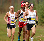 BROOKINGS, SD - OCTOBER 31:  Trent Lusignan from South Dakota State University leads Damon Pruett from IUPUI, Joel Reichow from SDSU, and Mubarak Musa from USD during the 2015 Summit League Cross Country Championships at Edgebrook Golf Course in Brookings. (Photo by Dave Eggen/Inertia)