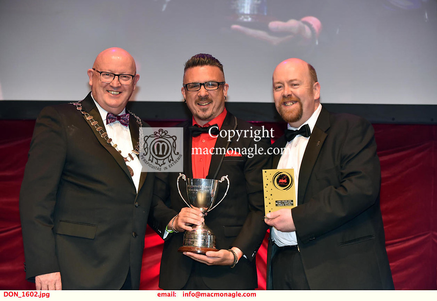 16-6-2019:  Declan Kiely- Bill Sykes- Oliver!-Carrigaline Musical Society, Cork winner of the Best Actor in a Supporting Role award at the annual AIMS (Association of Irish Musical Societies) in the INEC Killarney at the weekend receiving the trophy from Seamus Power, President, AIMS left and Rob Donnelly, Vice-President.<br /> Photo: Don MacMonagle - macmonagle.com<br /> <br /> repro free photo from AIMS<br /> <br /> AIMS PRESS RELEASE: There was plenty of glitz and glamour in Killarney on Saturday night as The Association of Irish Musical Societies has its Annual Awards Ceremony in Killarney. Over 1,500 people could be heard over the Kerry mountains as the winners were announced by MC Fergal D'Arcy. Many societies were double winners on the night including UCD Musical Society, Dublin were dancing all the way to the trophies winning Best Choreography and Best Choreographer for Leah Meagher for Cabaret and  Tullamore Musical Society who took their moment as Chris Corroon won Best Male Singer for his sinful performance as Henry Jekyll in Jekyll &Hyde and also Director Paul Norton who'd plenty to celebrate picking Best Director for  the same show. The moment was once again taken by Jekyll&Hyde by Dùn Laoighaire Musical&Dramatic Society as Kevin Hartnett took up Best Male Singer in the Sullivan category.Nenagh Youth Musical Society raised their voices high and took home Best Ensemble. It was a superior night for Enniscorthy Musical Society by winning Best Comedienne for Jennifer Byrne as Mother Superior and Best Technical too. Portlaoise Musical Society rose to the top by taking home Best Overall Show in the Gilbert section for their stunning production of Titanic. Oyster Lane Theatre Group, Wexford flew their flag high taking home Best Overall Show in the Sullivan Section for their breathtaking production of Michael Collins-a Musical Drama.<br /> Other winners on the night included Best Comedian for Ronan Walsh as Officer Lockstock in Urinetown for Trim Musical Societ