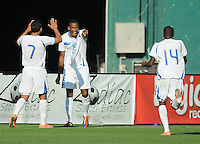 Honduras forward Allan Lalin (25) celebrates with teammates Emilio Izaguirre (7) and Oscar Garcia (14) his score in the 84th minute of the game. Honduras National Team defeated El Salvador 3-0 at RFK stadium, Saturday June 2, 2012.