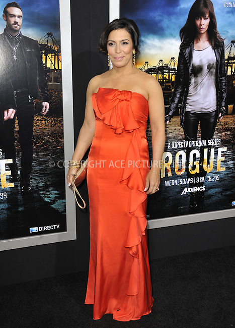 WWW.ACEPIXS.COM....March 26 2013, LA....Claudia Ferri arriving at the 'Rogue' Los Angeles premiere at ArcLight Hollywood on March 26, 2013 in Hollywood, California.....By Line: Peter West/ACE Pictures......ACE Pictures, Inc...tel: 646 769 0430..Email: info@acepixs.com..www.acepixs.com