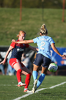 Piscataway, NJ, April 24, 2016.  Midfielder Tori Huster (23) of the Washington Spirit  sends the ball past onrushing Sky Blue midfielder  Shawna Gordon (2).  The Washington Spirit defeated Sky Blue FC 2-1 during a National Women's Soccer League (NWSL) match at Yurcak Field.