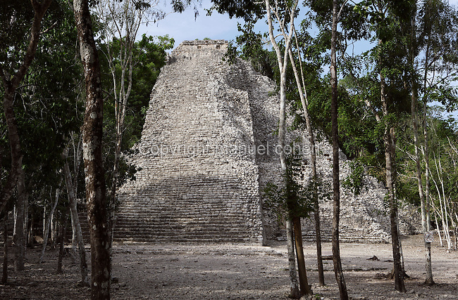 Nohoch Mul (?Big Hill?), 42 meters high, large pyramid of seven stepped units with rounded and inset corners topped by a temple similar to those at Tulum with niches depicting the Descending God, Early Classical Period, 325 ? 625 AD, Coba, Quintana Roo, Mexico. Picture by Manuel Cohen