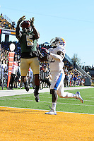 Baylor wide receiver Antwan Goodley (5) attempts to catch a pass defended by Kansas Dexter McDonald during NCAA football game, Saturday, November 01, 2014 in Waco, Tex. (Mo Khursheed/TFV Media via AP Images)