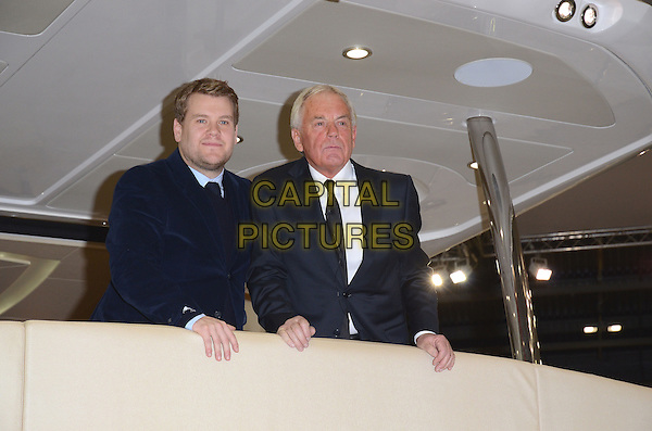 LONDON, ENGLAND - JANUARY 04:  James Corden &amp; Robert Braithwaite at the unveiling of the new Sunseeker 75 Yacht as part of the London International Boat Show 2014, Excel London Exhibition Centre, Western Gateway, on Saturday January 04, 2014 in London, England, UK<br /> CAP/BK/PP<br /> &copy;Michael Ball/PP/Capital Pictures