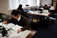 Los Angeles, California, November 30, 2010 - Pepperdine University MBA student, Yun 'Steven' Liu (far left) studies at the Graziadio School of Business and Management Library on the Malibu campus. The business school has a current enrollment of around 1,800 students spread over five campuses in and around Los Angeles, with a sixth slated to open in Santa Barbara, California this spring..
