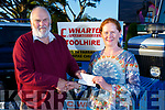 Chris Robbins (Ballymac Vintage Chairman) receiving a sponsorship cheque from Trish Wharton and Adrian Wharton on the Mini Land Rover at the launch the Ballymac Vintage Rally in O'Riada's Bar Ballymac on Monday evening
