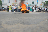 Pictured: Congress activists burn car tyres.<br />  Re: Activists of the Congress political party clash with police in protest against price rises in oil, gas and other daily commmodities by BJP government in Agartala, in the Tripura area of India. Monday 10 September 2018